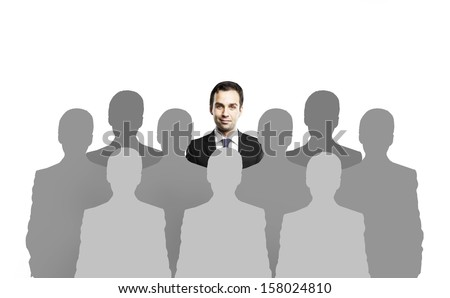 man standing among people silhouettes - stock photo