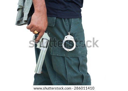 man standing and hand holding gun revolver ,side view isolate on white background - stock photo