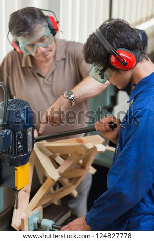 Man standing at a drilling machine working - stock photo