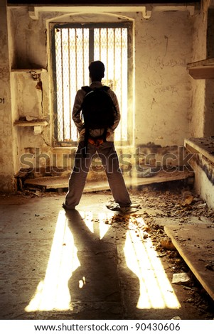 Man standing before Ancient window. - stock photo