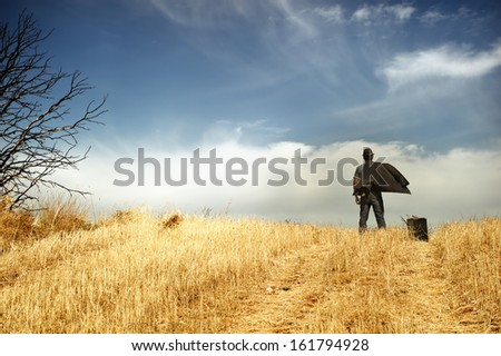 Man standing in a field - stock photo