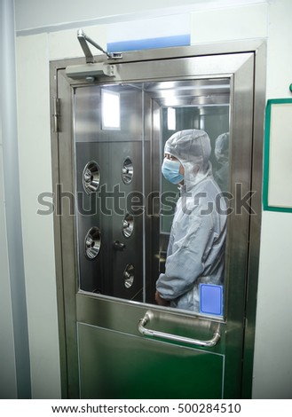 Man standing in air shower and dust removal room
