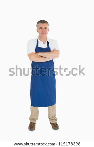 Man standing in blue apron - stock photo