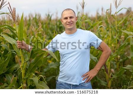 man standing in field of corn - stock photo