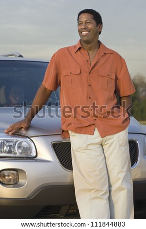 Man standing in front a car