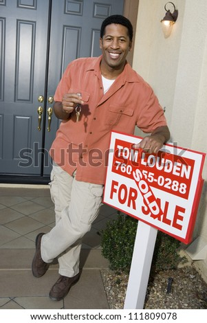 Man standing in front of a new home