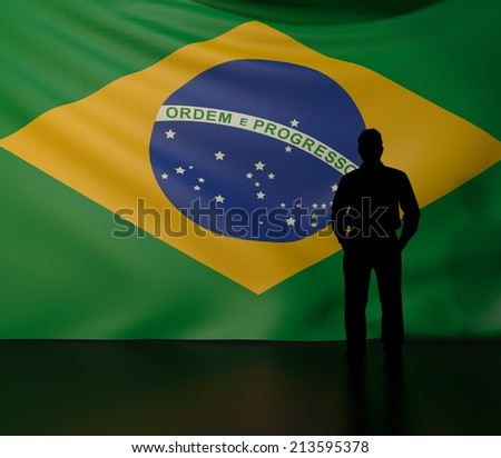 Man standing in front of flag of brazil; stage presentations - stock photo