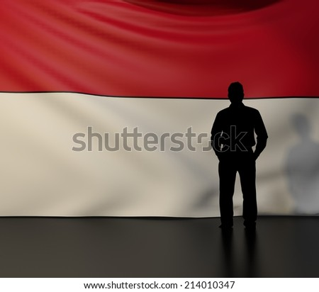 Man standing in front of flag of indonesia; stage presentations