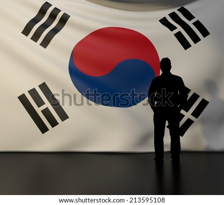 Man standing in front of flag of south korea; stage presentations - stock photo