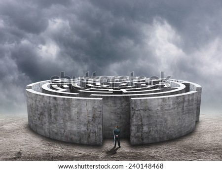 Man standing in front of the circular labyrinth - stock photo