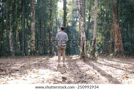 Man standing in the forest - stock photo