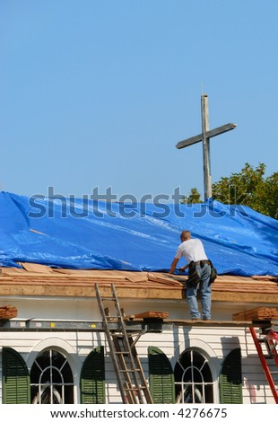 Man Standing On A Ladder Repairing Church Roof With Blue Tarp On It