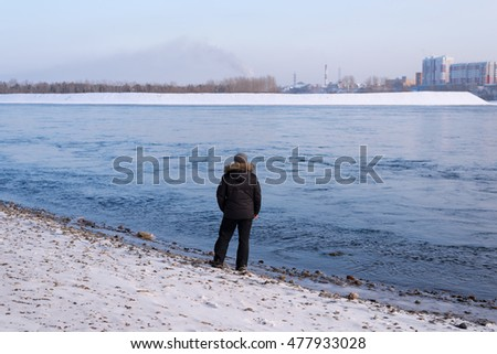 Man standing on a river bank