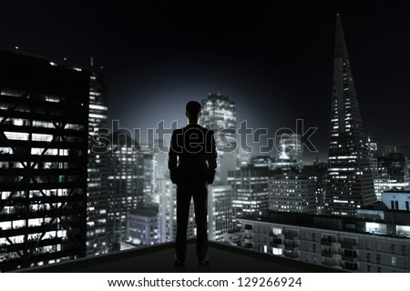 man standing on concrete room with drawing lamp - stock photo