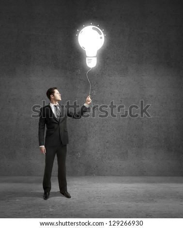 man standing on concrete room with drawing lamp