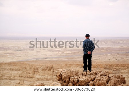 Man standing on mountain hill