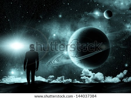 man standing on the background of the cosmic landscape - stock photo