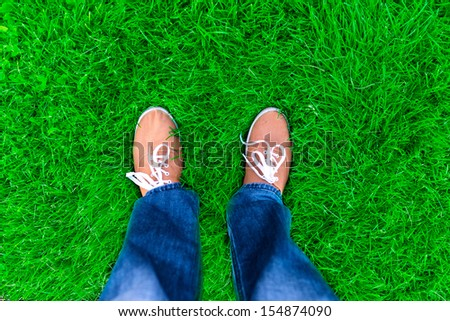 man standing on the grass - stock photo