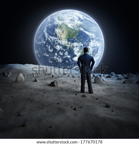 "Man standing on the moon, looking at the Earth?""Elements of this image furnished by NASA"" - stock photo"