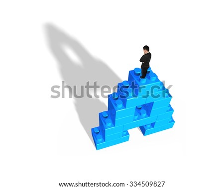 Man standing on top of alphabet letter A shape stack blocks, isolated on white background.
