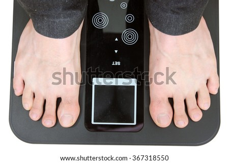 man standing on Weighed scale digital  - stock photo
