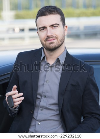 man standing out of his car - stock photo