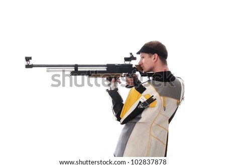 Man standing sideways taking aim with an air rifle isolated on white