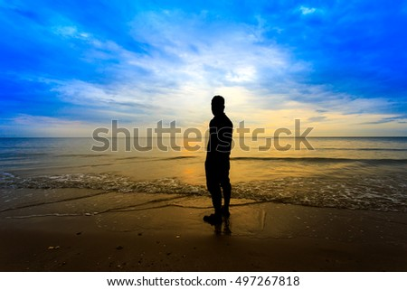 Man standing sunset On the coast, tropical