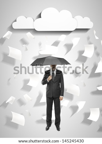man standing with umbrella with flying around paper
