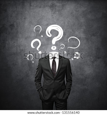 man standing without head with drawing question marks - stock photo