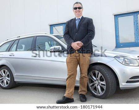 Man stands on the car - stock photo