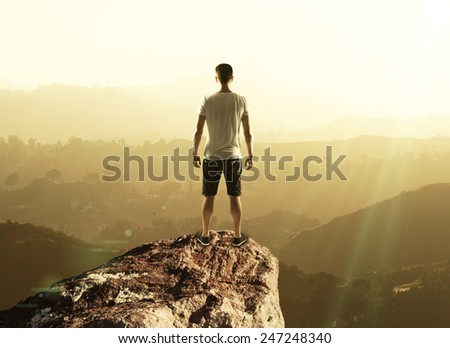 man stands on top mountain, close up - stock photo