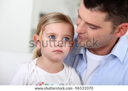 Man staring lovingly at his daughter - stock photo