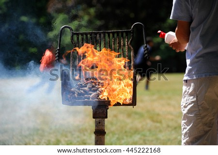 man start barbecue and igniting the coal by fire starter - stock photo
