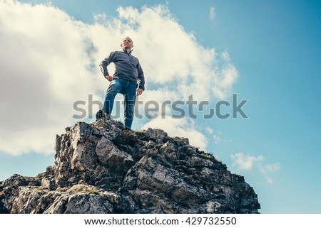 Man stay on the top of mountain - stock photo