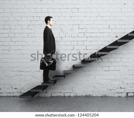 man stepping up a staircase - stock photo