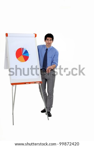 Man stood by flip-chart giving presentation - stock photo