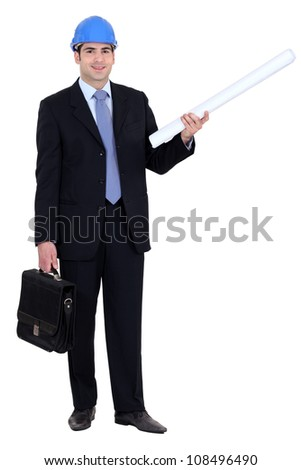 Man stood with briefcase and construction plans