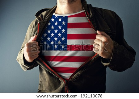 Man stretching jacket to reveal shirt with USA flag printed. Concept of patriotism and national team supporting  for 4th of July - stock photo