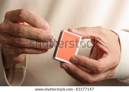 Man striking a match - stock photo