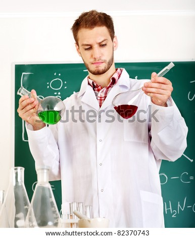 Man student with flask in classroom.
