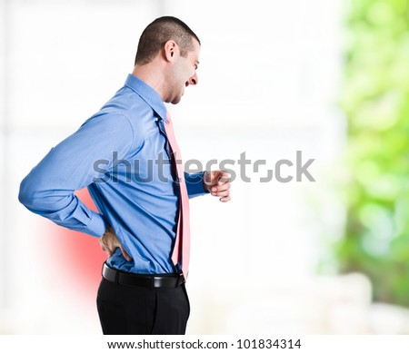 Man suffering for a backache - stock photo