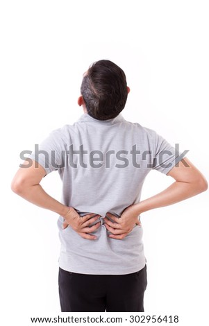 man suffering from back pain, hand holding back - stock photo