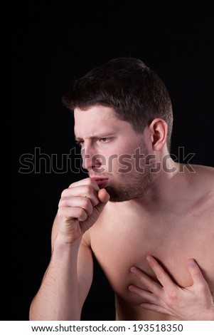 Man suffering from cough on isolated background - stock photo
