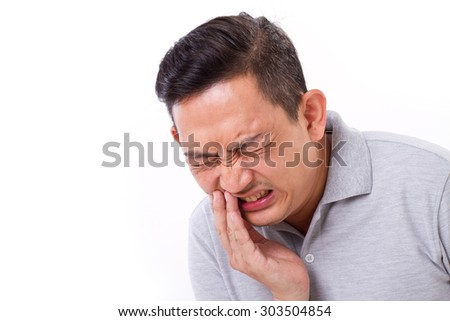 man suffering from toothache, tooth sensitivity - stock photo