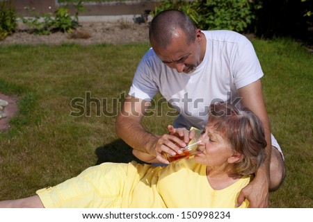 Man supplied old woman with heat stroke - stock photo