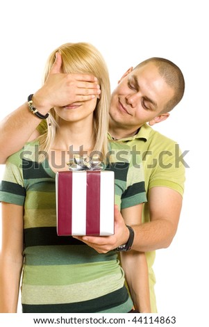man surprising a woman with present over white background