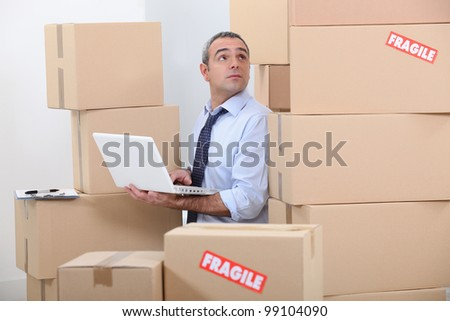 Man surrounded by cardboards - stock photo