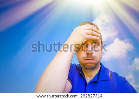 Man sweating on a hot summer day - stock photo