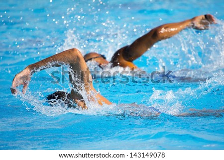 Man swimmer in swimming pool - stock photo